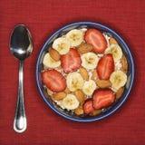Frühstück-Schüssel und Löffel Lizenzfreies Stockbild