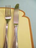 Frühstückeinstellungsbrotserviette-Gabelmesser Stockfoto