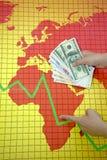 för handpengar för kris ekonomisk värld Arkivfoto