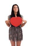 För valentindagen för kvinnan undertecknar hållande hjärta Fotografering för Bildbyråer