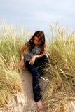 Fra l'erba Fotografia Stock