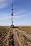 Fracking Drilling in a Colorado Field. A fracking rig sits in an farmers field in Colorado Royalty Free Stock Photo
