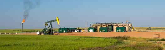 Fracking in north dakota. Oil derricks pumping in america Royalty Free Stock Images