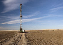 Fracking rig in a Colorado farm field. A controversial fracking rig drills in a field in a Colorado farm plot Royalty Free Stock Image