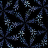 Fractal abstraction, ornamentation of snowflakes on a black background Stock Photos