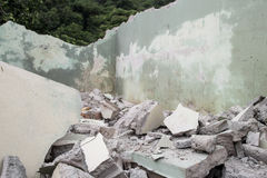 Fraction of cement building collapse. (selective focus royalty free stock photography
