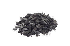 Fraction of charcoal. On a white background Royalty Free Stock Photos