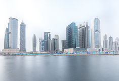 Fraction of Dubai Business Bay district skyline on a cloudy day. Dubai, UAE. Stock Photo