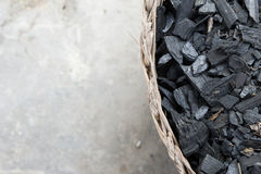 Fraction of dust charcoal in the woven basket Stock Image