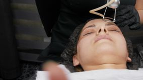 Fractional laser CO2. Cosmetic procedure. Woman having a laser skin treatment in a skincare clinic, a resurfacing. Technique for wrinkles, scars and solar stock video footage