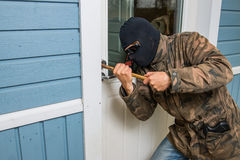 Fractional man breaking into a residential building in Finland. royalty free stock image