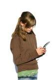 Fractura adolescente para arriba sobre un mensaje de texto Fotos de archivo