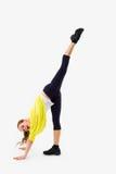 fractura Mujer joven que hace estirando ejercicio Imagen de archivo libre de regalías
