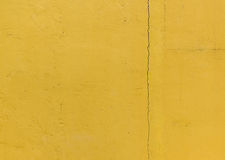 Fracture in the wall, Yellow grunge cement wall, texture backgro Royalty Free Stock Photo
