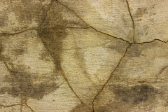 Fractured concrete surface closeup background or texture. Fractured concrete surface closeup background or texture Stock Images