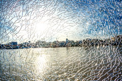 Fractured Mirror. On blurred river and city background Stock Photography