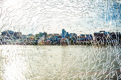 Fractured Mirror on blurred river. And city background Stock Photos
