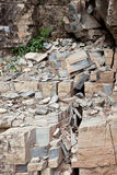 Fractured Rocks. A mountain side with fractured slate rocks broken apart in square shapes and falling down from erosion in Glacier National Park, Montana Stock Photo