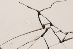Fractured white concrete background. Old cracked plaster floor top view, copy space Royalty Free Stock Photo
