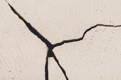 Fractured white concrete background. Old cracked plaster floor top view, copy space Royalty Free Stock Photography