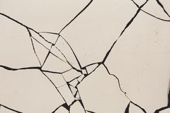 Fractured white concrete background. Old cracked plaster floor top view, copy space Stock Photography