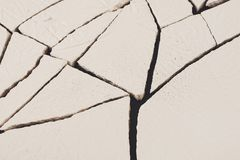 Fractured white concrete background. Old cracked plaster floor top view, copy space Stock Image