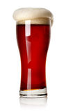 Fradga på rött öl arkivbild