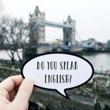 Fragen Sie Sie sprechen Englisch? in London Großbritannien lizenzfreie stockfotografie