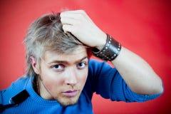 Fragender junger Mann Stockfotos