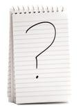 Fragezeichen auf gewundenem Notizbuch Stockbild