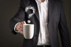 Fragezeichen vom Kaffeedampf Rauch, der ein Symbol bildet lizenzfreie stockbilder