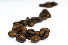 Fragezeichen von den Kaffeebohnen Stockfotos