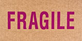 Fragile. The word FRAGILE in red on a brown cardboard box Stock Photos