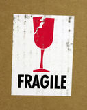 Fragile. Deteriorated Fragile label on a product box that finally arrived Royalty Free Stock Photos