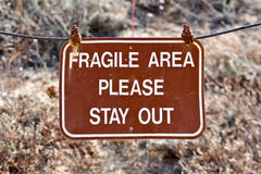 Fragile area. Brown warning sign to stay out of fragile area royalty free stock photo