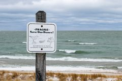 Fragile Beauty Of Nature. Fragile Save Our Dunes! Sign posted by the Michigan Department of Natural Resources. Port Crescent State Park. Port Austin, Michigan stock photos