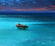 Fragile boat in a stormy sea Royalty Free Stock Photography