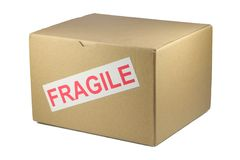 Fragile box. Cardboard box with Fragile on it, isolated on white royalty free stock photos