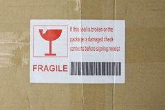 Fragile Box. Fragile sticker with an illustration and barcode on top of a box Royalty Free Stock Image