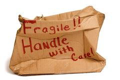 Fragile Brown Box XXXL. Crushed large shipping box isolated on white, but with some shadows Royalty Free Stock Images