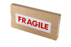 Fragile Cardboard Box. A small DVD sized cardboard box with a red FRAGILE sticker on it Stock Photos
