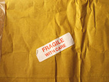 Fragile with care. Detail of a fragile corrugated cardboard packet Royalty Free Stock Images