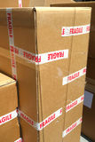 Fragile Content. Brown moving boxes marked Fragile royalty free stock image