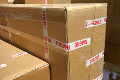 Fragile Content. Brown moving boxes marked Fragile Stock Photo