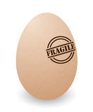 Fragile egg. Conceptual illustration of a cracked egg with fragile stamp Stock Photos