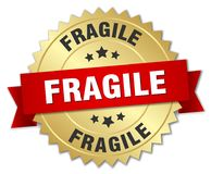Fragile. Gold badge with red ribbon royalty free illustration