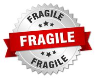 Fragile. Silver badge with red ribbon royalty free illustration