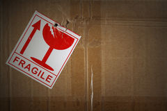 Fragile freight. Fragile label on side of cardboard box royalty free stock images