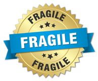 Fragile. Gold badge with blue ribbon vector illustration
