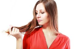 Fragile hair. Woman is not happy with her fragile hair Stock Photography